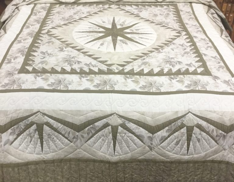 mariner's compass quilt made by the amish of lancaster county