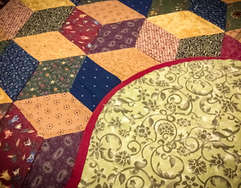 front and back of amish handmade quilt