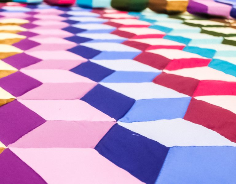 closeup of tumbling blocks quilt pattern