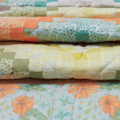 scrap quilts in many colors from family farm fabrics